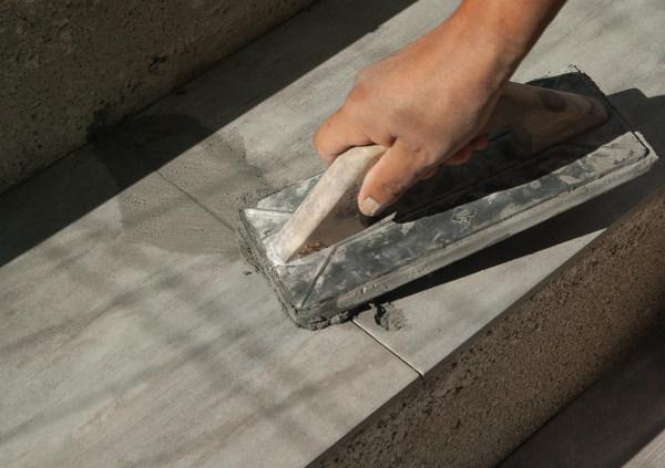 Choosing a Tiler - Tiler grouting floor tiles