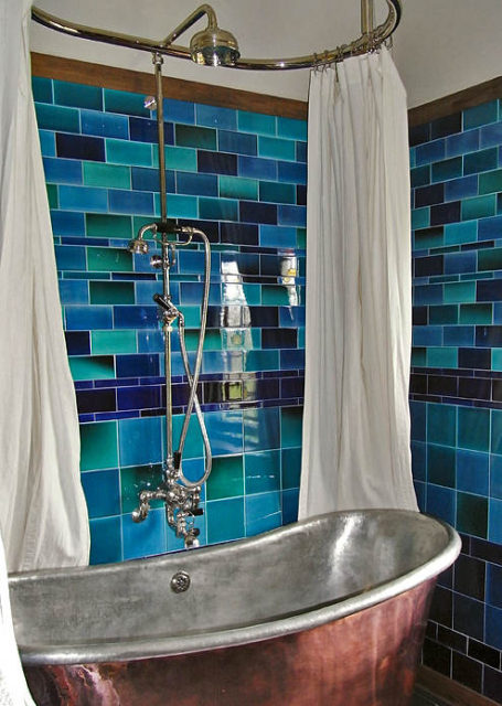 Blue tiles on a bathroom wall